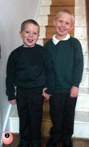 Two cheeky boys on their first day of school