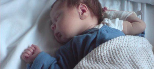 newborn with cannula