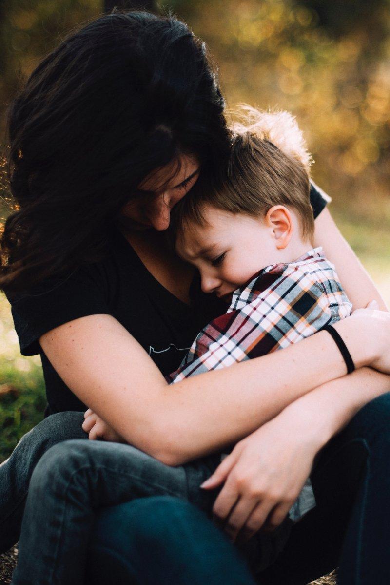 mother comforting upset child