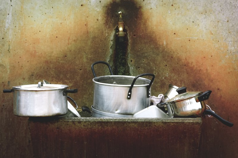 sink full of dirty pans