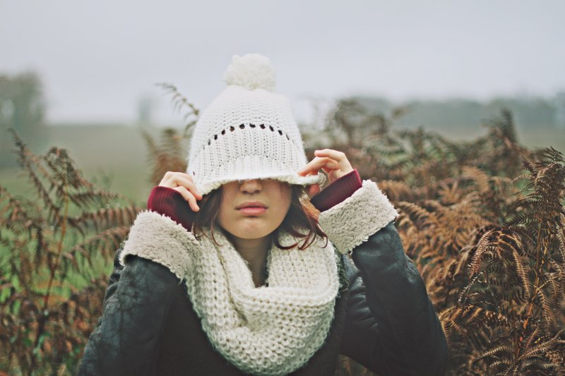 Christmas Gift of being alone - woman covering her eyes with a hat