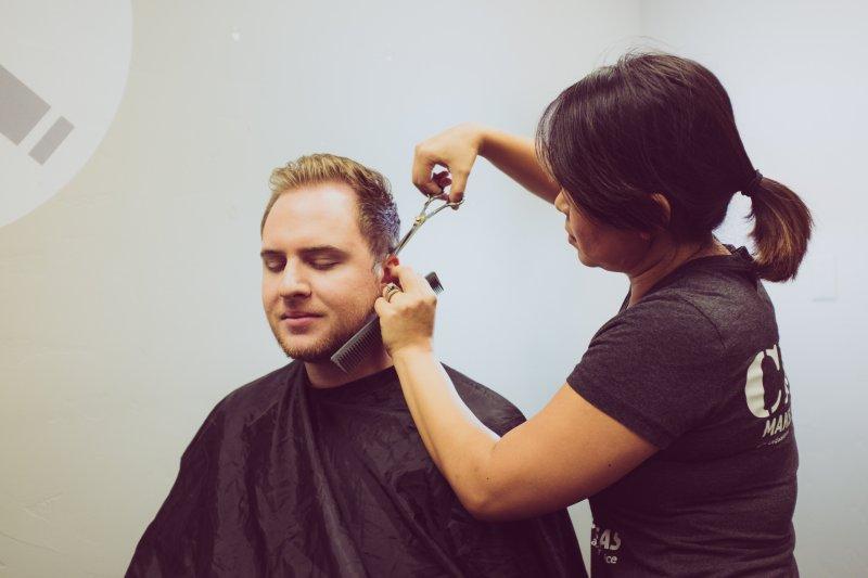 man having hair cut