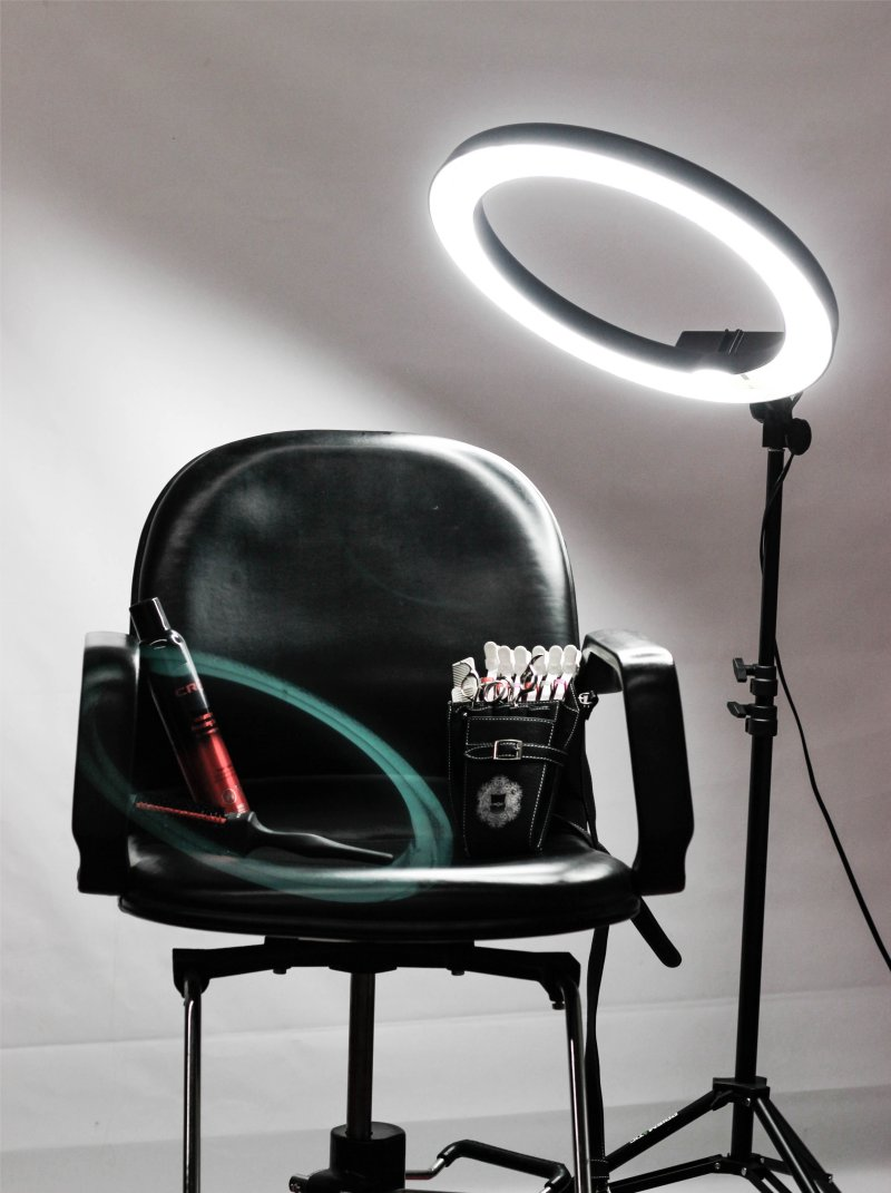 empty hair dressers chair and light