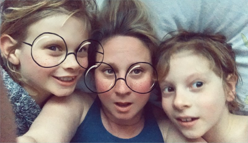mother and 2 sons using snapchat